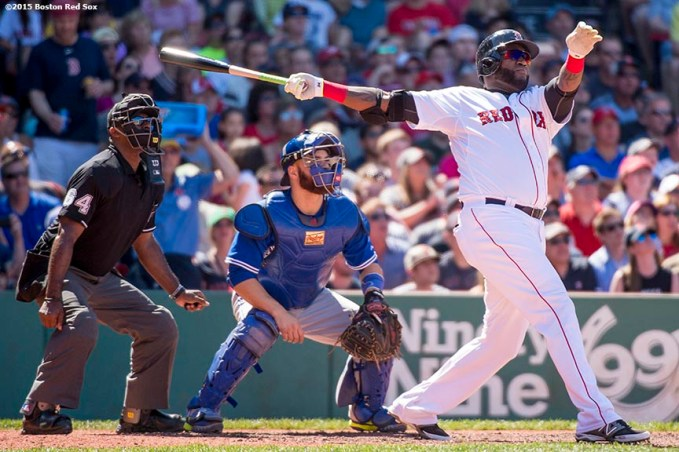 """Boston Red Sox designated hitter David Ortiz hits a three run home run during the fifth inning of a game against the Toronto Blue Jays at Fenway Park in Boston, Massachusetts Sunday, June 14, 2015."""