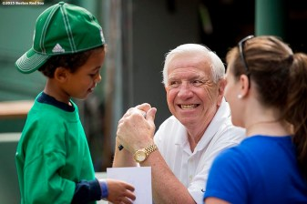 """Former Boston Red Sox catcher Bob Montgomery greets a young fan during a Genesis Fund event at Fenway Park in Boston, Massachusetts Thursday, June 18, 2015."""