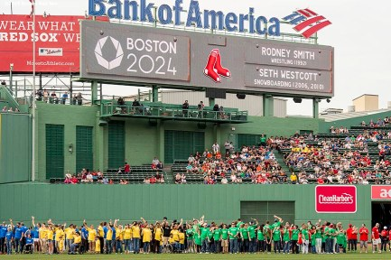 """Olympian hopefuls are introduced in centerfielder during a Boston 2024 Olympic Games ceremony before a game between the Boston Red Sox and the Baltimore Orioles at Fenway Park in Boston, Massachusetts Tuesday, June 23, 2015."""