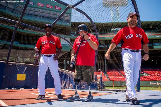 """""""A veteran takes batting practice with Boston Red Sox hitting coach Chili Davis and assistant hitting coach Victor Rodriguez during a CVS Hitting Clinic at Fenway Park in Boston, Massachusetts Friday, July 3, 2015."""""""