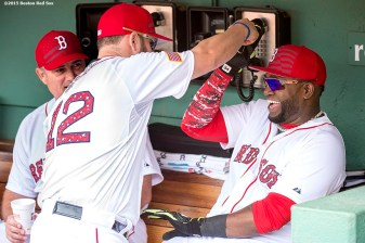 """First baseman Mike Napoli and designated hitter David Ortiz laugh before a game between the Boston Red Sox and the Houston Astros at Fenway Park in Boston, Massachusetts Saturday, July 4, 2015."""