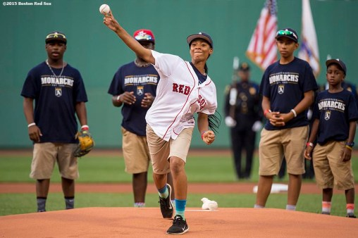 """Pitcher Mo'ne Davis of the Anderson Monarchs Little League World Series team throws out the ceremonial first pitch before a game between the Boston Red Sox and the Houston Astros at Fenway Park in Boston, Massachusetts Tuesday July 7, 2015."""