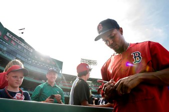 """Boston Red Sox shortstop Xander Bogaerts signs autographs before a game against the Miami Marlins at Fenway Park in Boston, Massachusetts Wednesday, July 8, 2015."""