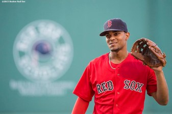 """Boston Red Sox shortstop Xander Bogaerts warms up before a game against the New York Yankees at Fenway Park in Boston, Massachusetts Friday, July 10, 2015."""