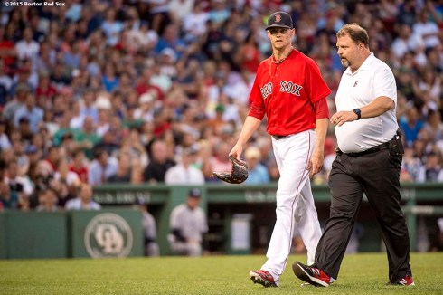 """Boston Red Sox pitcher Clay Buchholz exits the game during the fourth inning of a game against the New York Yankees at Fenway Park in Boston, Massachusetts Friday, July 10, 2015."""