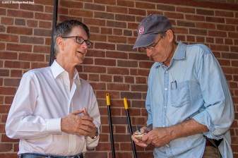 """""""Boston Red Sox Principal Owner John Henry talks with singer James Taylor before a concert at Fenway Park in Boston, Massachusetts Thursday, August 6, 2015."""""""