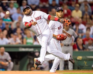 """""""Boston Red Sox third baseman Pablo Sandoval throws to first base as pitcher Eduardo Rodriguez looks on during the first inning of a game against the Cleveland Indians at Fenway Park in Boston, Massachusetts Tuesday, August 18, 2015."""""""