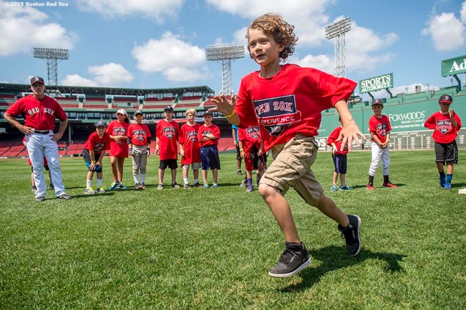 """""""A participant takes part in a base running drill during a Sox Talk clinic at Fenway Park in Boston, Massachusetts Wednesday, August 19, 2015."""""""
