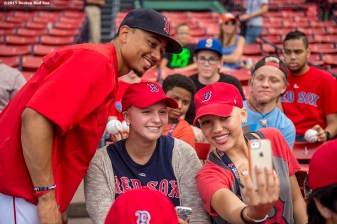 """""""Boston Red Sox center fielder Mookie Betts poses for a selfie photograph during a Jimmy Fund meet and greet at Fenway Park in Boston, Massachusetts Saturday, August 22, 2015."""""""