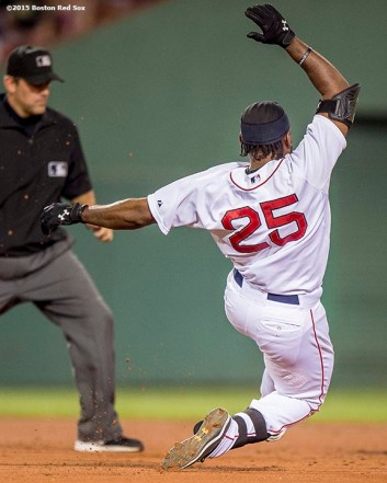 """Boston Red Sox left fielder Jackie Bradley Jr. slides after hitting a double during the fifth inning of a game against the New York Yankees at Fenway Park in Boston, Massachusetts Tuesday, September 1, 2015."""