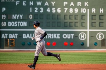"""""""New York Yankees designated hitter Alex Rodriguez jogs toward the dugout during the first inning of a game against the Boston Red Sox at Fenway Park in Boston, Massachusetts Wednesday, September 2, 2015."""""""