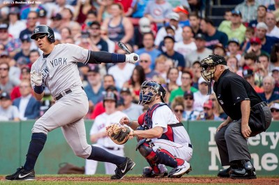 """""""New York Yankees designated hitter Alex Rodriguez hits a single during the second inning of a game against the Boston Red Sox at Fenway Park in Boston, Massachusetts Wednesday, September 2, 2015."""""""
