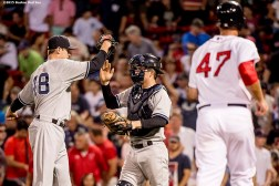 """""""New York Yankees pitcher Andrew Miller and catcher Brian McCann high five after defeating the Boston Red Sox at Fenway Park in Boston, Massachusetts Wednesday, September 2, 2015."""""""