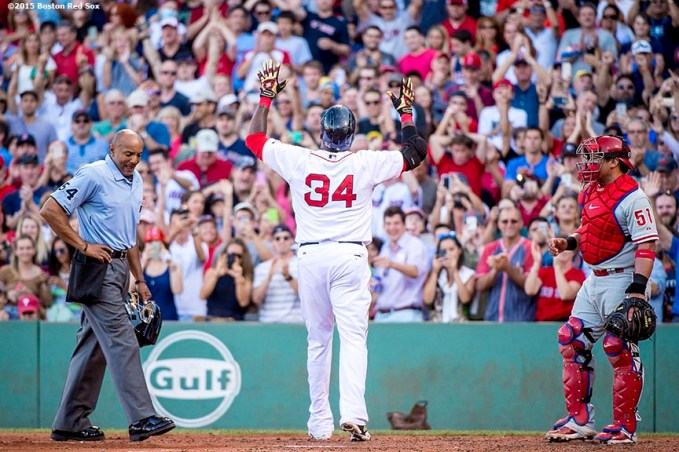 """""""Boston Red Sox designated hitter David Ortiz reacts after hitting a solo home run during the fourth inning of a game against the Philadelphia Phillies at Fenway Park in Boston, Massachusetts Saturday, September 5, 2015. It was home run number 496 of his career."""""""