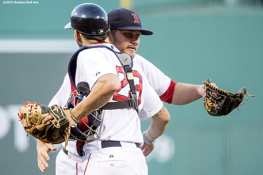 """""""Boston Red Sox pitcher Wade Miley hugs catcher Blake Swihart after pitching a complete game against the Philadelphia Phillies at Fenway Park in Boston, Massachusetts Saturday, September 5, 2015."""""""