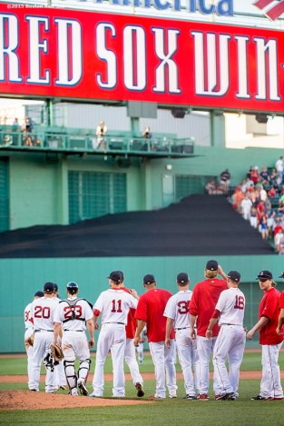 """""""Members of the Boston Red Sox line up after defeating the Philadelphia Phillies at Fenway Park in Boston, Massachusetts Saturday, September 5, 2015."""""""