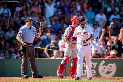 """Boston Red Sox designated hitter David Ortiz hits a solo home run during the first inning of a game against the Philadelphia Phillies at Fenway Park in Boston, Massachusetts Sunday, September 6, 2015. It was home run number 497 of his career. """