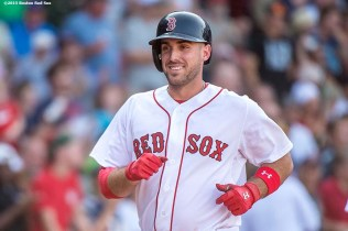 """Boston Red Sox first baseman Travis Shaw reacts after hitting a two run home run during eighth the inning of a game against the Toronto Blue Jays at Fenway Park in Boston, Massachusetts Monday, September 7, 2015."""