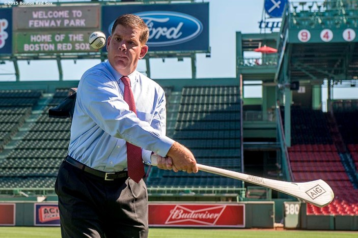 """Boston Mayor Martin J. Walsh practices hurling technique during a press conference announcing the AIG Fenway Hurling Classic and Irish Festival Announcement, at Fenway Park in Boston, Massachusetts Tuesday, September 15, 2015."""