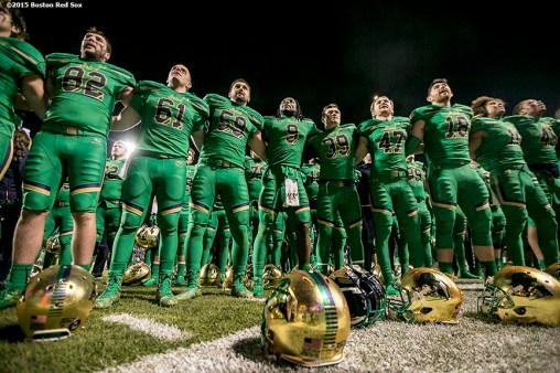 """Members of Notre Dame sing their Alma Mater song after the Shamrock Series Football at Fenway game against Boston College at Fenway Park in Boston, Massachusetts Saturday, November 21, 2015."""