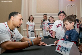 """""""Boston Red Sox outfielder Mookie Betts signs autographs at the 2016 Winter Weekend at Foxwoods Resort & Casino in Ledyard, Connecticut Saturday, January 23, 2016."""""""