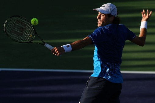 """""""Guido Pella in action against Pablo Cuevas during the 2016 BNP Paribas Open at the Indian Wells Tennis Garden in Indian Wells, California Saturday, March 12, 2016."""""""