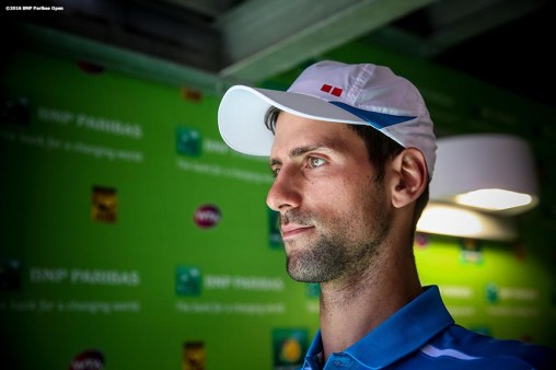 """Novak Djokovic walks through the tunnel before the men's finals match against Milos Raonic during the 2016 BNP Paribas Open at the Indian Wells Tennis Garden in Indian Wells, California Sunday, March 20, 2016."""