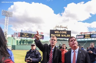 """Boston Red Sox President Sam Kennedy points out new ballpark features with Boston Mayor Marty Walsh during a walk through of Fenway Park in Boston, Massachusetts Friday, April 8, 2016."""
