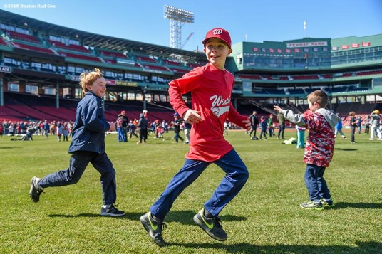 """Fans play in the outfield during Little League Opening Day at Fenway Park in Boston, Massachusetts Saturday, April 9, 2016."""