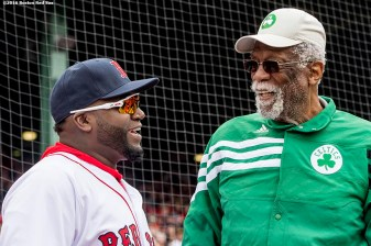 BOSTON, MA - APRIL 11: David Ortiz #34 of the Boston Red Sox and former Boston Celtics player Bill Russell talk before throwing a ceremonial first pitch during the home opener against the Baltimore Orioles on April 11, 2016 at Fenway Park in Boston, Massachusetts . (Photo by Billie Weiss/Boston Red Sox/Getty Images) *** Local Caption *** David Ortiz; Bill Russell