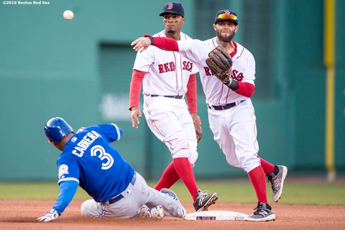 BOSTON, MA - APRIL 16: Dustin Pedroia #15 and Xander Bogaerts #2 of the Boston Red Sox turn a double play as Ezequiel Carrera #3 of the Toronto Blue Jays slides during the eighth inning of a game on April 16, 2016 at Fenway Park in Boston, Massachusetts . (Photo by Billie Weiss/Boston Red Sox/Getty Images) *** Local Caption *** Xander Bogaerts; Ezequiel Carrera; Dustin Pedroia