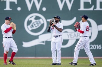 BOSTON, MA - APRIL 16: Brock Holt #12, Jackie Bradley Jr. #25, and Mookie Betts #50 of the Boston Red Sox react after defeating the Toronto Blue Jays on April 16, 2016 at Fenway Park in Boston, Massachusetts . (Photo by Billie Weiss/Boston Red Sox/Getty Images) *** Local Caption *** Brock Holt; Jackie Bradley Jr.; Mookie Betts