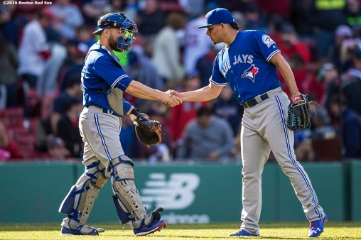BOSTON, MA - APRIL 17: Roberto Osuna #54 and Russell Martin #55 shake hands after recording the final out against the Boston Red Sox on April 17, 2016 at Fenway Park in Boston, Massachusetts . (Photo by Billie Weiss/Boston Red Sox/Getty Images) *** Local Caption *** Roberto Osuna; Russell Martin