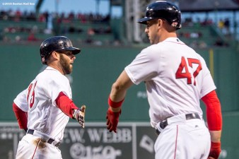 BOSTON, MA - APRIL 28: Dustin Pedroia #15 high fives Travis Shaw #47 of the Boston Red Sox after scoring during the first inning of a game against the Atlanta Braves on April 28, 2016 at Fenway Park in Boston, Massachusetts . (Photo by Billie Weiss/Boston Red Sox/Getty Images) *** Local Caption *** Dustin Pedroia; Travis Shaw