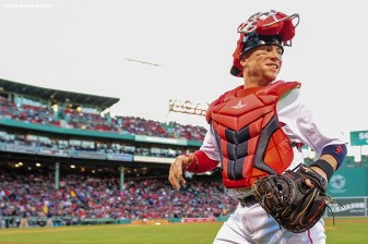 BOSTON, MA - APRIL 30: Christian Vazquez #7 of the Boston Red Sox runs onto the field before a game against the New York Yankees on April 30, 2016 at Fenway Park in Boston, Massachusetts . (Photo by Billie Weiss/Boston Red Sox/Getty Images) *** Local Caption *** Christian Vazquez