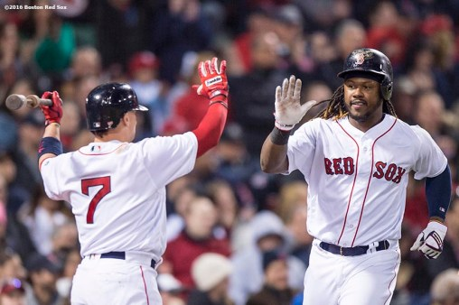 BOSTON, MA - APRIL 30: Hanley Ramirez #13 of the Boston Red Sox high fives Christian Vazquez #7 after scoring during the seventh inning of a game against the New York Yankees on April 30, 2016 at Fenway Park in Boston, Massachusetts . (Photo by Billie Weiss/Boston Red Sox/Getty Images) *** Local Caption *** Hanley Ramirez; Christian Vazquez