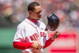 BOSTON, MA - MAY 15: Mookie Betts #50 of the Boston Red Sox flips his helmet during the first inning of a game against the Houston Astros on May 15, 2016 at Fenway Park in Boston, Massachusetts. (Photo by Billie Weiss/Boston Red Sox/Getty Images) *** Local Caption *** Mookie Betts