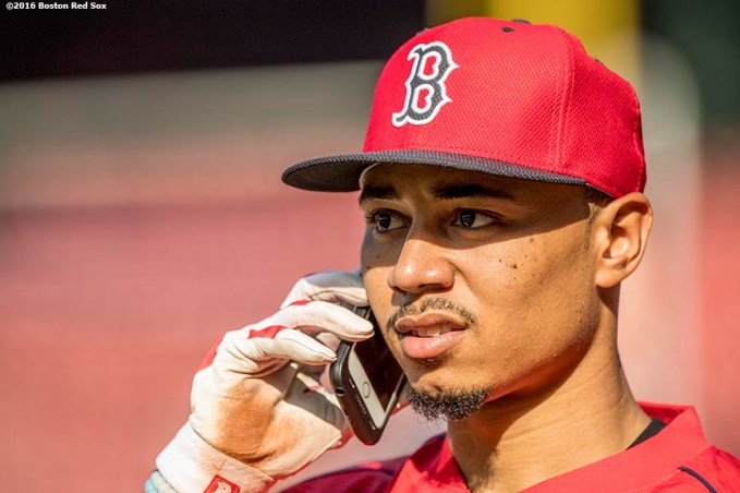 BOSTON, MA - MAY 20: Mookie Betts #50 of the Boston Red Sox talks on the phone before a game against the Cleveland Indians on May 20, 2016 at Fenway Park in Boston, Massachusetts. (Photo by Billie Weiss/Boston Red Sox/Getty Images) *** Local Caption *** Mookie Betts