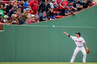 BOSTON, MA - MAY 22: Blake Swihart #23 of the Boston Red Sox throws a pack of peanuts to a fan who dropped them on the field after catching a fly ball during the second inning of a game against the Cleveland Indians on May 22, 2016 at Fenway Park in Boston, Massachusetts. (Photo by Billie Weiss/Boston Red Sox/Getty Images) *** Local Caption *** Blake Swihart
