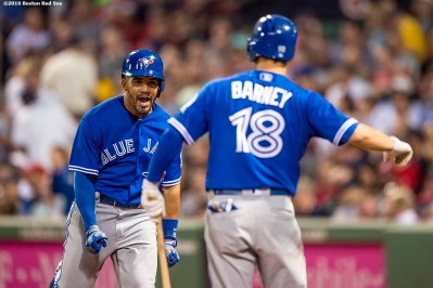 BOSTON, MA - JUNE 3: Devon Travis #29 of the Toronto Blue Jays reacts with Darwin Barney #18 after hitting a two run home run during the eighth inning of a game against the Boston Red Sox on June 3, 2016 at Fenway Park in Boston, Massachusetts. (Photo by Billie Weiss/Boston Red Sox/Getty Images) *** Local Caption *** Devon Travis; Darwin Barney