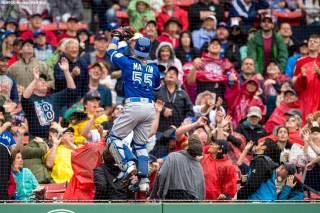 BOSTON, MA - JUNE 5: Russell Martin #55 of the Toronto Blue Jays climbs the wall as he attempts to catch a foul ball during the first inning of a game against the Boston Red Sox on June 5, 2016 at Fenway Park in Boston, Massachusetts. (Photo by Billie Weiss/Boston Red Sox/Getty Images) *** Local Caption *** Russell Martin