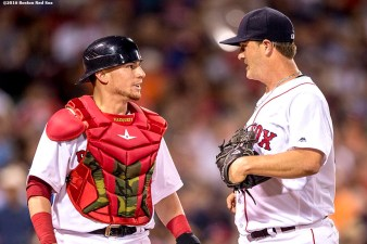 BOSTON, MA - JUNE 15: Christian Vazquez #7 and Steven Wright #35 of the Boston Red Sox talk as they walk off the field during the seventh inning of a game against the Baltimore Orioles on June 15, 2016 at Fenway Park in Boston, Massachusetts. (Photo by Billie Weiss/Boston Red Sox/Getty Images) *** Local Caption *** Steven Wright; Christian Vazquez