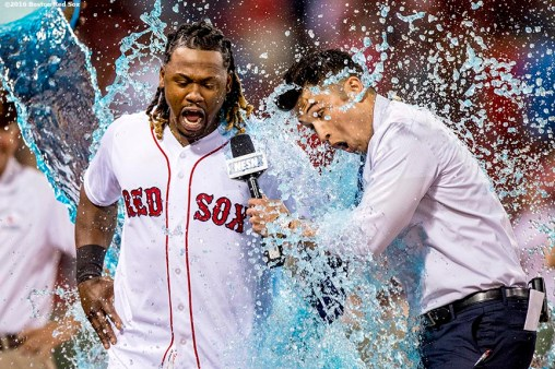 BOSTON, MA - JUNE 15: Hanley Ramirez #13 of the Boston Red Sox is given a Powerade bath alongside NESN reporter Gary Striewski after a game against the Baltimore Orioles on June 15, 2016 at Fenway Park in Boston, Massachusetts. (Photo by Billie Weiss/Boston Red Sox/Getty Images) *** Local Caption *** Hanley Ramirez; Gary Striewski