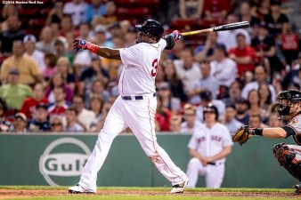BOSTON, MA - JUNE 16: David Ortiz #34 of the Boston Red Sox hits a solo home run during the ninth inning of a game against the Baltimore Orioles on June 16, 2016 at Fenway Park in Boston, Massachusetts. (Photo by Billie Weiss/Boston Red Sox/Getty Images) *** Local Caption *** David Ortiz