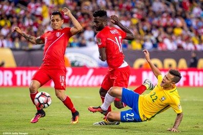 FOXBORO, MASSACHUSETTS - JUNE 12: Philippe Coutinho of Brazil falls as he is defended by Yoshimar Yotún of Peru during a group B match between Brazil and Peru at Gillette Stadium as part of Copa America Centenario US 2016 on June 12, 2016 in Foxboro, Massachusetts, US. (Photo by Billie Weiss/LatinContent/Getty Images)