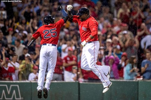 BOSTON, MA - JULY 1: David Ortiz #34 of the Boston Red Sox reacts with Jackie Bradley Jr. #25 after hitting a solo home run during the fifth inning of a game against the Los Angeles Angels of Anaheim on July1, 2016 at Fenway Park in Boston, Massachusetts. It was home run number 522 of his career, moving him into sole possession of 19th place on the all-time home run list. (Photo by Billie Weiss/Boston Red Sox/Getty Images) *** Local Caption *** David Ortiz; Jackie Bradley Jr.