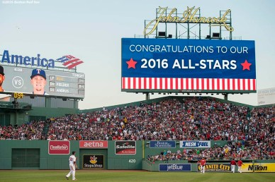 BOSTON, MA - JULY 5: Mookie Betts #50 of the Boston Red Sox warms up as a message is displayed on the scoreboard announcing members of the Boston Red Sox selected to the 2016 Major League Baseball All-Star Game during the third inning of a game against the Texas Rangers on July 5, 2016 at Fenway Park in Boston, Massachusetts. (Photo by Billie Weiss/Boston Red Sox/Getty Images) *** Local Caption *** Mookie Betts