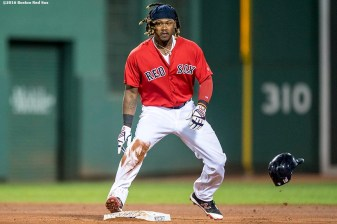 BOSTON, MA - JULY 8: Hanley Ramirez #13 of the Boston Red Sox loses his helmet after stealing second base during the sixth inning of a game against the Tampa Bay Rays on July 8, 2016 at Fenway Park in Boston, Massachusetts. (Photo by Billie Weiss/Boston Red Sox/Getty Images) *** Local Caption *** Hanley Ramirez