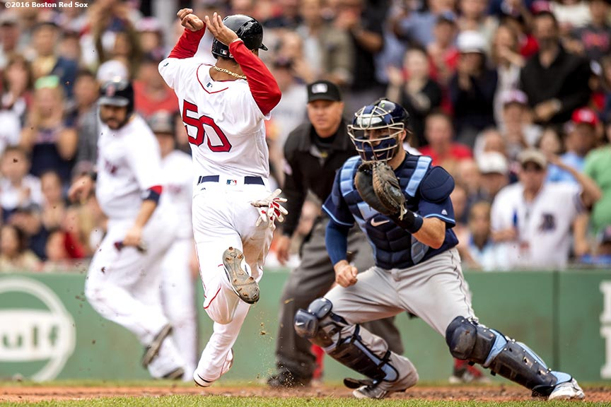 BOSTON, MA - JULY 8: Mookie Betts #50 of the Boston Red Sox evades the tag of Curt Casali #19 of the Tampa Bay Rays to score during the inning fifth of a game on July 9, 2016 at Fenway Park in Boston, Massachusetts. (Photo by Billie Weiss/Boston Red Sox/Getty Images) *** Local Caption *** Mookie Betts; Curt Casali