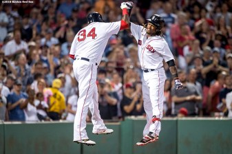 BOSTON, MA - JULY 23: Hanley Ramirez #13 of the Boston Red Sox reacts with David Ortiz #34 after hitting a three run home run during the second inning of a game against the Minnesota Twins on July 23, 2016 at Fenway Park in Boston, Massachusetts. (Photo by Billie Weiss/Boston Red Sox/Getty Images) *** Local Caption *** Hanley Ramirez; David Ortiz